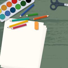 Art supplies on wooden desk