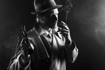 Film noir: gangster smoking and holding a gun