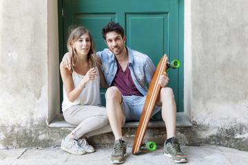 young couple of skateborder in relax