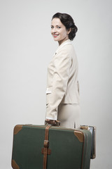 Attractive vintage woman with suitcases