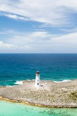 Small White Lighthouse on Sandy Beach