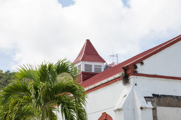 White Plaster Building with Red Tile Roof in Tropics