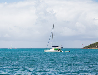 White Sailboat Under Mast on Blue Water