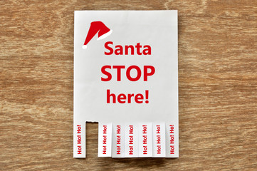 Santa Stop Here on advertising paper notice and tear off feedbac