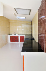 empty concrete counter kitchen with black counter tops