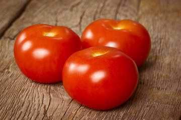 Three ripe tomatoes