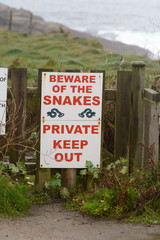 Beware of the snakes sign