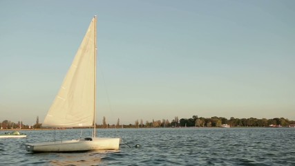 sailing boat rocking on the lake