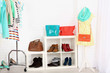 Different clothes on hangers, shoes on shelves in shop - 73716405