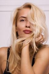 blonde girl posing in white room