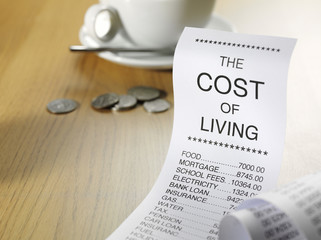 Cost of living and running home finances on a printout