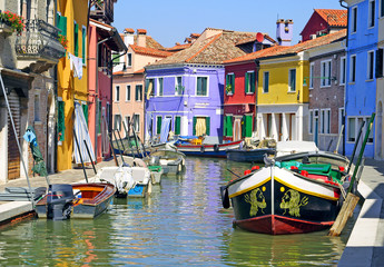 Canal with colorful houses on the famous island Burano, Venice