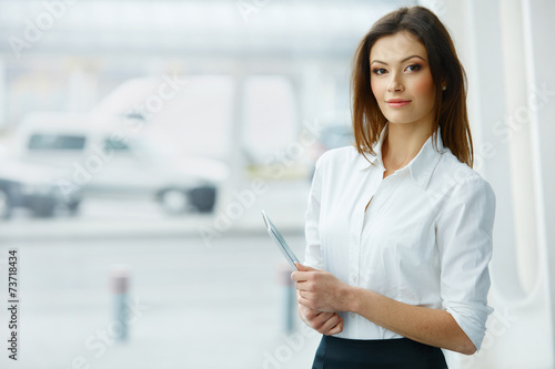 Business Woman Holding a Tablet Computer. - 73718434