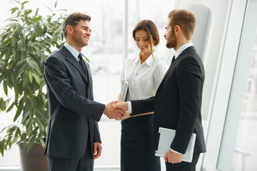 Businessman shaking hands. People shake hands communicating with