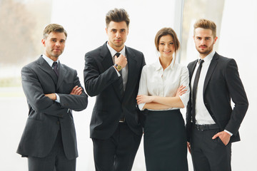 Business Team. Happy smiling people standing in a row at office