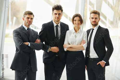 canvas print picture Business Team. Happy smiling people standing in a row at office
