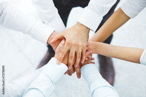 International business team showing unity with their hands toget - 73718699