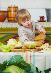 Toddle helping around the kitchen with big cabbage