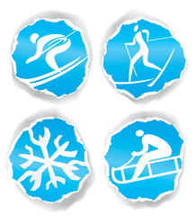 Winter sport icons on torn paper