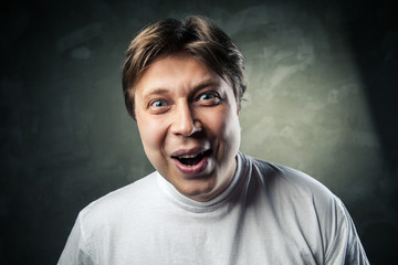 Young beautiful man surprised face expression