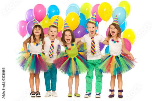 Leinwanddruck Bild Group of joyful little kids having fun at birthday party