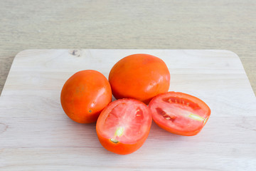 Tomatoes on wooden kitchen table