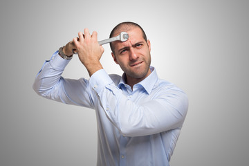 Man using a wrench to fix his brain
