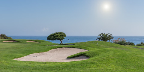 Panorama of a golf course on a sea background. for tourists.
