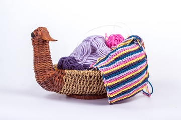 piece of knitting with a ball in a wicker basket - duck