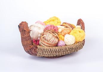 multi-colored balls of yarn in a wicker basket - duck