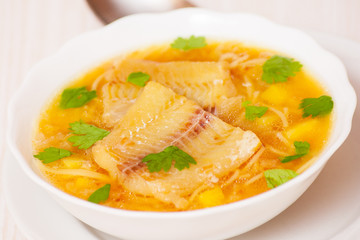 Fish soup with potato and noodles