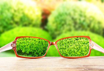 Vision concept. Eye glasses on wooden table outdoors