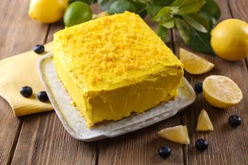 Tasty lemon cake on wooden table