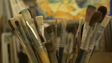 Paint brushes in the pot on the table at drawing lesson