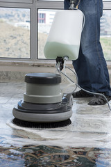 Industrial buffing machine polishing the floor.
