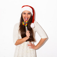 christmas portrait of happy girl with candy