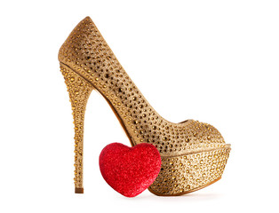 Sexy gold shoe with heart.Valentine Christmas shopping.