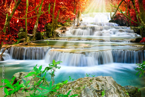 Beautiful waterfall in autumn forest - 73726224