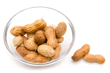 Peanuts on glass bowl on white background