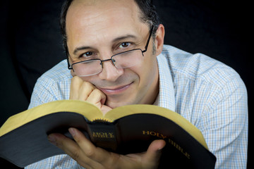 Man Reading Holy Bible