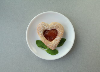 heart cookies on a plate close to