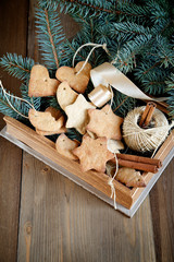Christmas gingerbread cookies in a box with fir branches