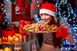 Woman preparing for Christmas dinner - 73727454