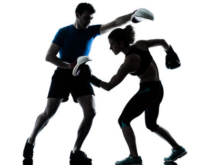 man woman boxing training silhouette