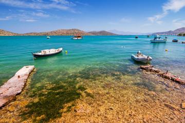Fishing boats on the blue lagoon of Crete, Greece
