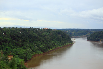 view of river Iguazu from international bridge between Brazil