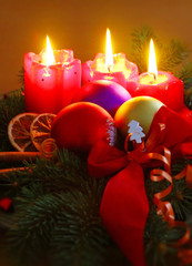 Three Advent candles and christmas decoration .