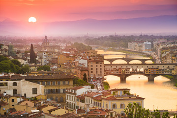 Colorful sunset over Ponte Vecchio on Arno River, Florence, Ital