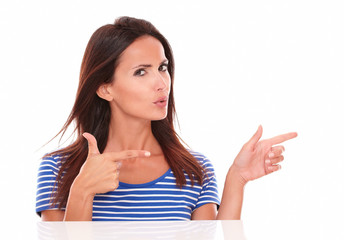 Charming brunette with fingers gesturing a handgun