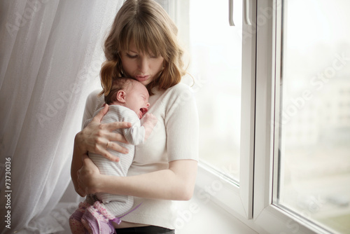 mother with cute little crying baby - 73730036